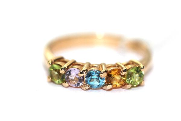 Золотое кольцо сцитрином, хризолитом, топазом иаметистом