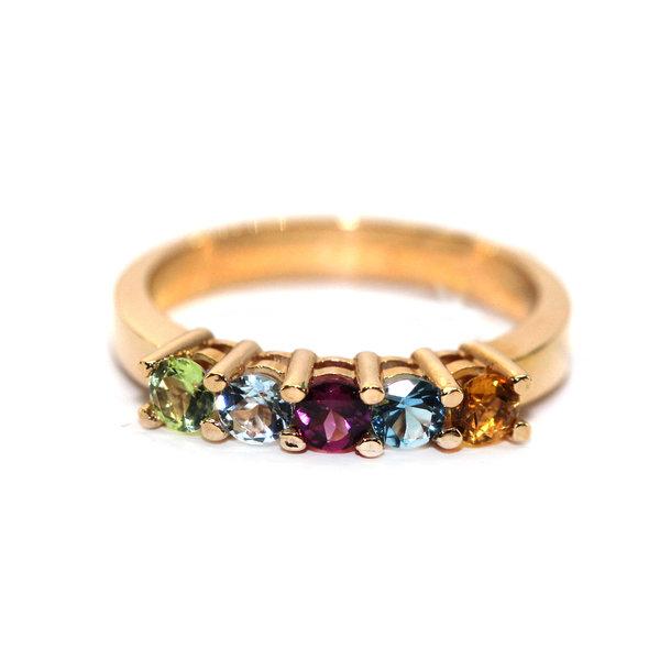Золотое кольцо сцитрином, хризолитом, топазом иродолитом