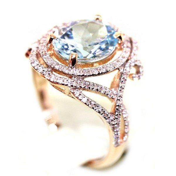 Золотое кольцо стопазом ифианитом