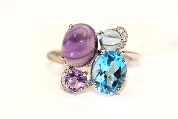 Золотое кольцо стопазом, бриллиантом иаметистом